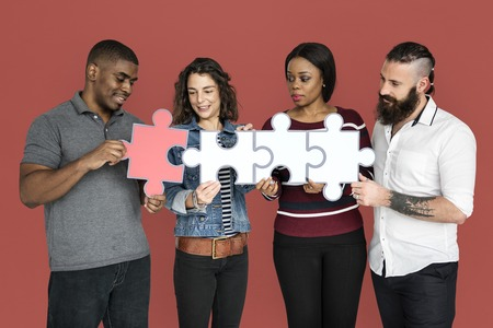 large group of business people: People are holding puzzle together Stock Photo