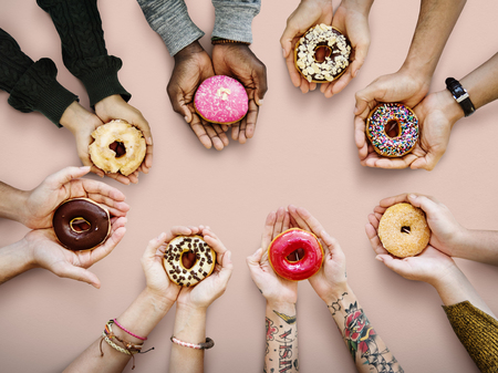 People holding donuts