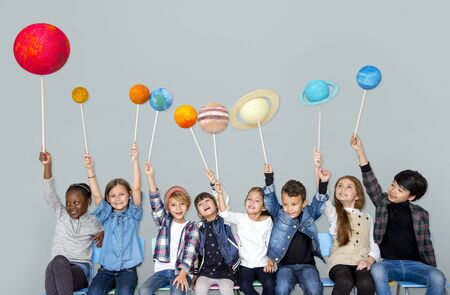 Happy Diverse group of kids holding planets
