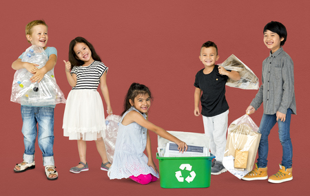 niños reciclando: Diverse Group Of Kids Recycling Garbage Foto de archivo