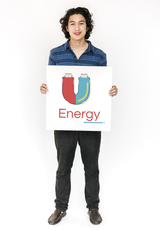 Man holding banner of horseshoe magnetic field energy illustration