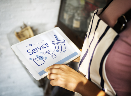Illustration of home cleaning service on digital tablet Stock Photo