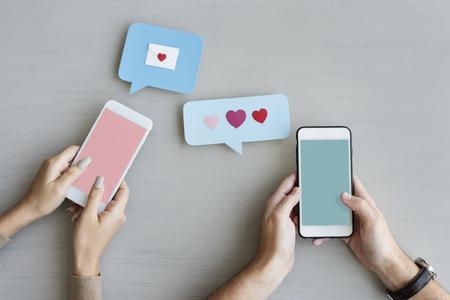 Hands Holding Mobile Phone Sending Heart Message Speech Bubble