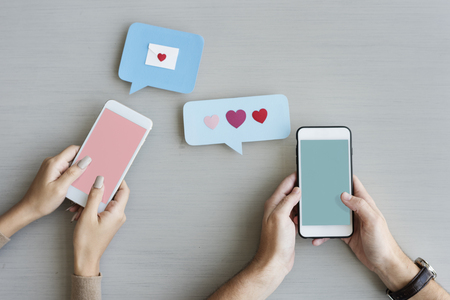 Hands Holding Mobile Phone Sending Heart Message Speech Bubble