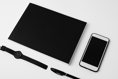 Black notebook and watch on the desk Stok Fotoğraf