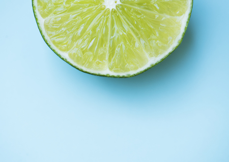 Slice lime on blue background Stock Photo - 81440547