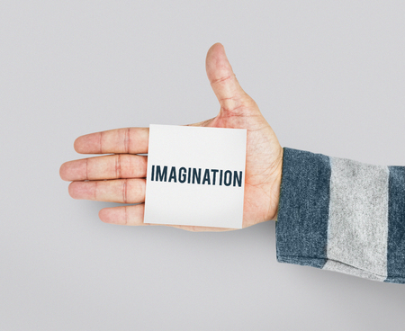 Hand with Sticky Note Showing Imagination Word Banco de Imagens