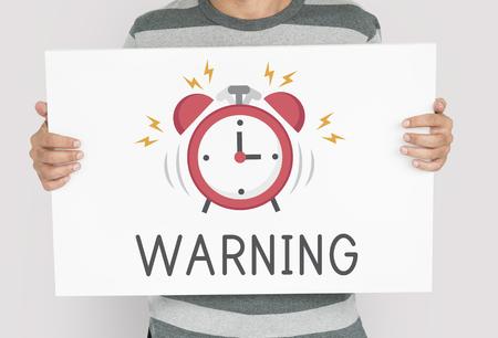 Man holding banner of alarm clock icon notification illustration 版權商用圖片