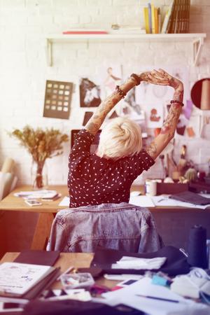 Fashion designer tattooed girl stretching