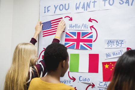 High school students working on international flags board Banque d'images
