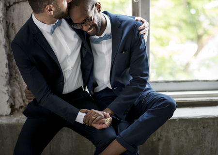 Gay Couple in Navy Blue Tuxedo Sitting Together Banco de Imagens