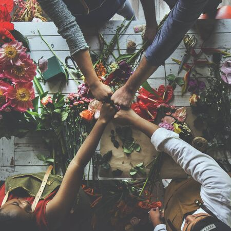 Group of people decorate the flower