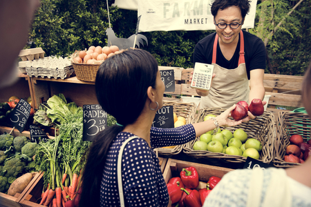 grocer: Greengrocer selling organic fresh agricultural product at farmer market Stock Photo