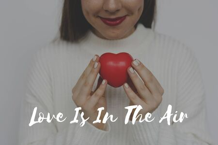 fascinate: Woman Holding Heart Love Amor Affection Word Graphic