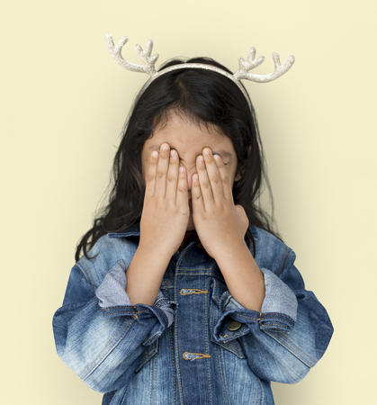 Little Girl Cover Eyes Wearing Reindeer Hairband