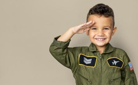 Little boy with pilot dream job salute and smiling Banco de Imagens - 81494668
