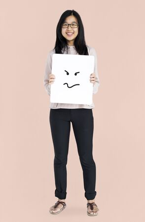 Asian girl holding placard studio portrait