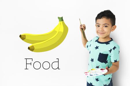 little boy with illustration of fresh organic delicious banana