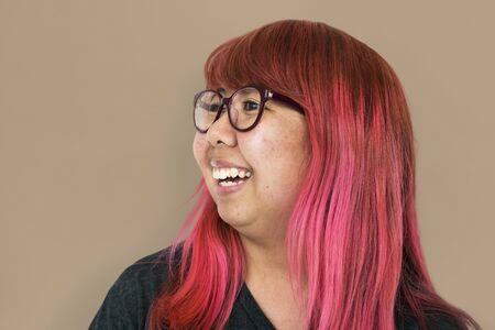 Asian girl pink hair smiling