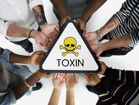 Group of people with skull icon and toxin dangerous word Reklamní fotografie