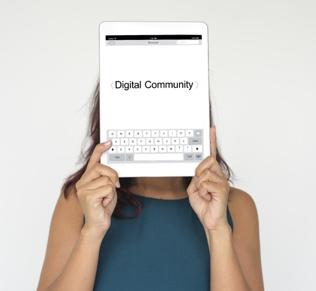 Woman holding network graphic overlay digital device covering face Фото со стока - 81494842