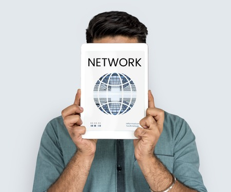 techie: Man holding network graphic overlay digital device