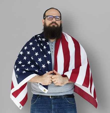 Man holding flag and posing for photoshoot Stock Photo