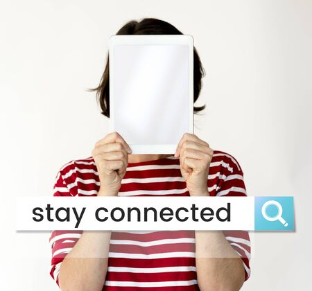 Woman holding digital device covering face network graphic Stock Photo