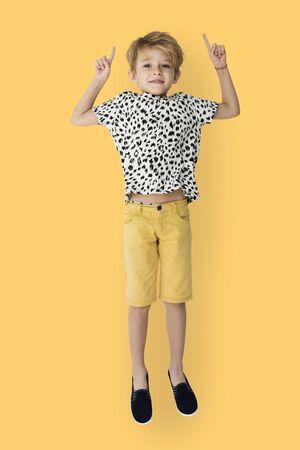 Young blonde boy jumping mid-air portrait 版權商用圖片