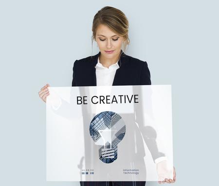 inspire: Woman holding banner of creative ideas digital technology light bulb