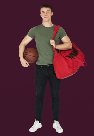 Young man with a basketball and a bag