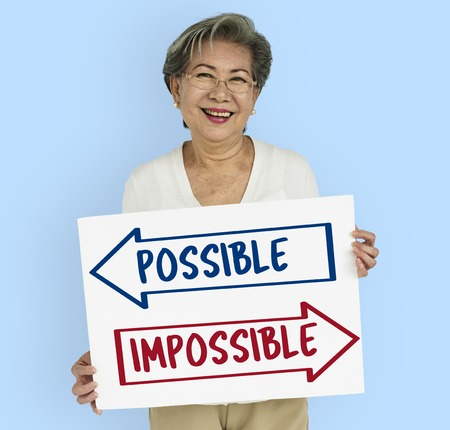 Woman with impossible and possible concept Stock Photo