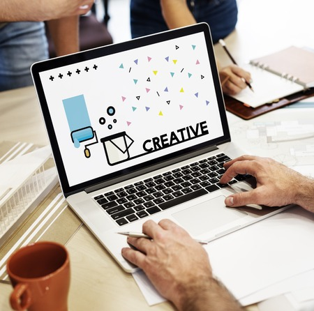 taking notes: Graphic of creative art design on laptop