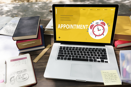 appointment book: Illustrationr of alarm clock notification for important appointment on laptop Stock Photo