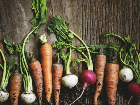 Carrots and turnips on a wooden table