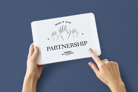 generosity: Hands working on digital device network graphic overlay