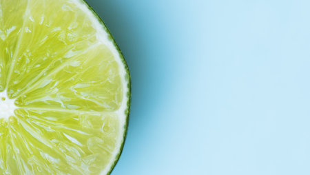 Slice lime on blue background Stock Photo - 81656052