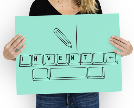 course development: Invent on keyboard with pencil graphic Stock Photo