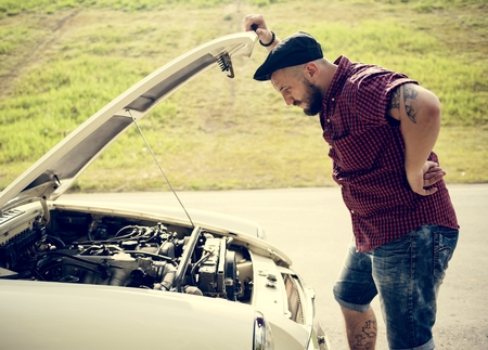 Men Checking Broke Down Car on Street Side with Open Hood