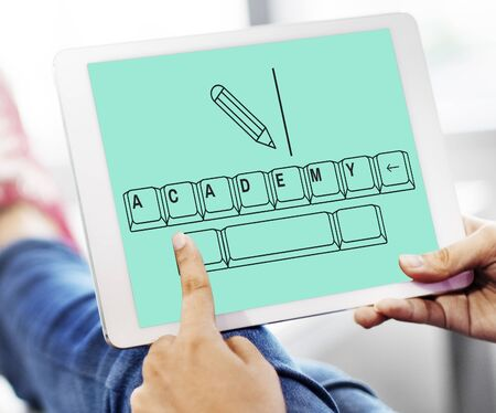 Online education pencil and keyboard graphic Stock Photo