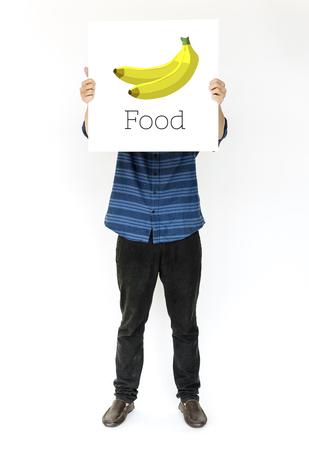 新鮮な有機おいしいバナナ イラストのバナーを抱きかかえた