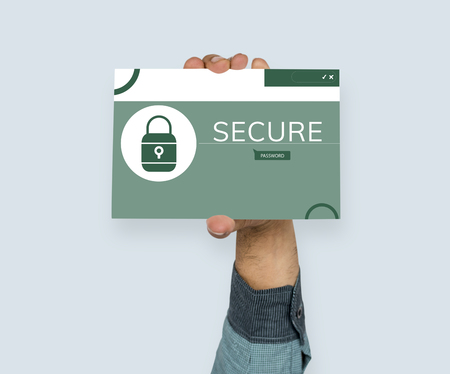 Hand holding banner with illustration of computer security system Stock Photo