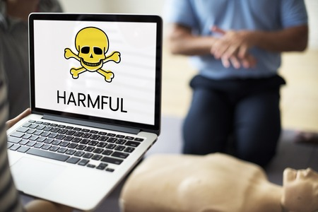 Digital device with the screen of skull icon and chemicals toxin word Stock Photo