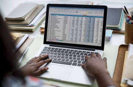 techie: Woman working with data on the laptop