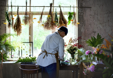 Florist working on the workspace in flower shop