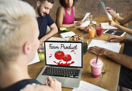 using laptop: Organic Vegetables Fresh Tomato Concept Stock Photo