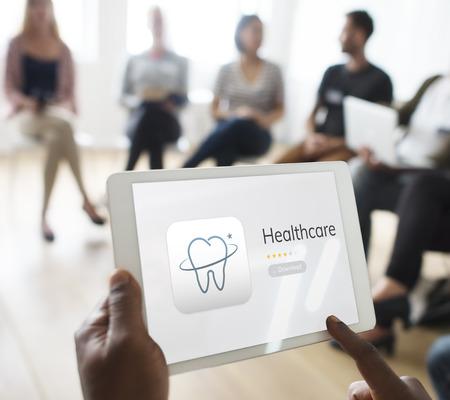 Illustration of dental care application on digital tablet Reklamní fotografie