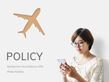 Woman using mobile phone with illustration of aviation life insurance traveling trip
