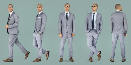Businessman lifestyle gesture confidence profession standing on background Banco de Imagens