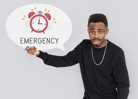 beware: African man holding speech bubble alarm clock icon Stock Photo